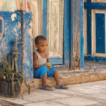 Across from our casa this young boy seemed to be waiting for a playmate one morning.